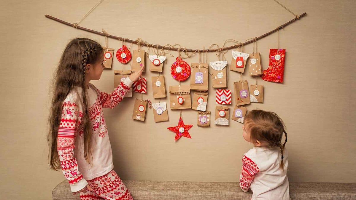 two little girls looking at a homemade DIY advent calendar