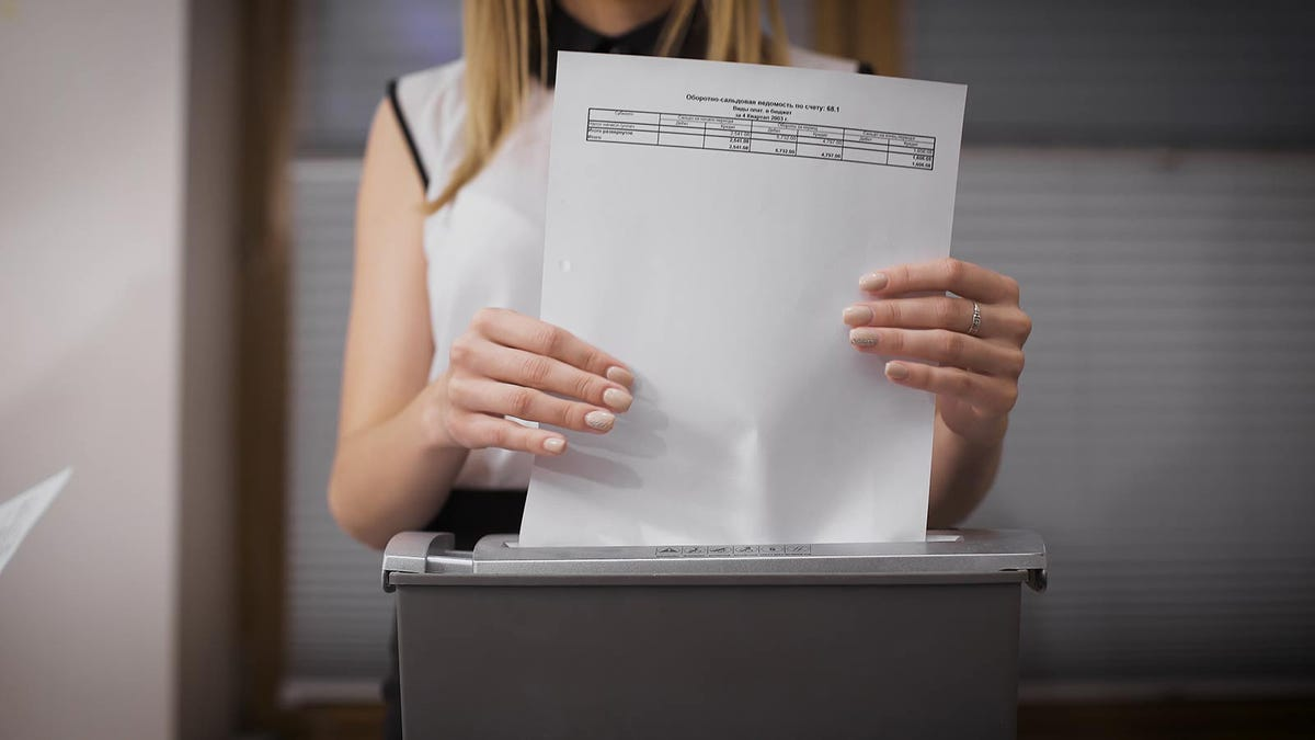woman shredding documents