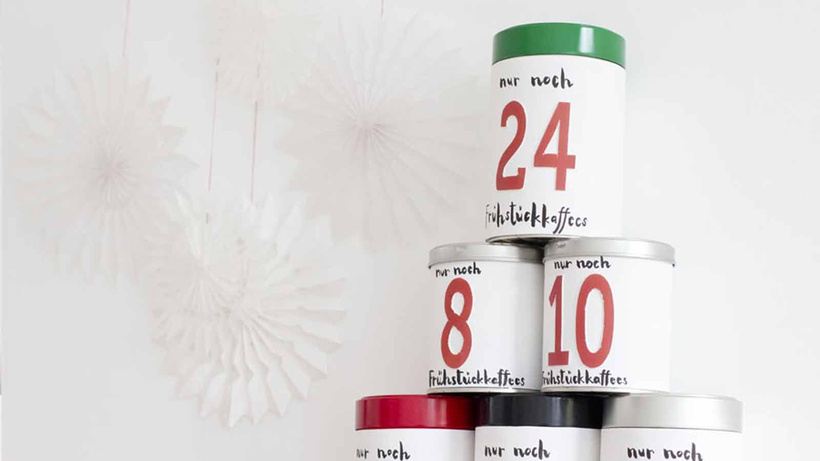 coffee cans, labeled with the date, stacked up in an advent calendar pyramid