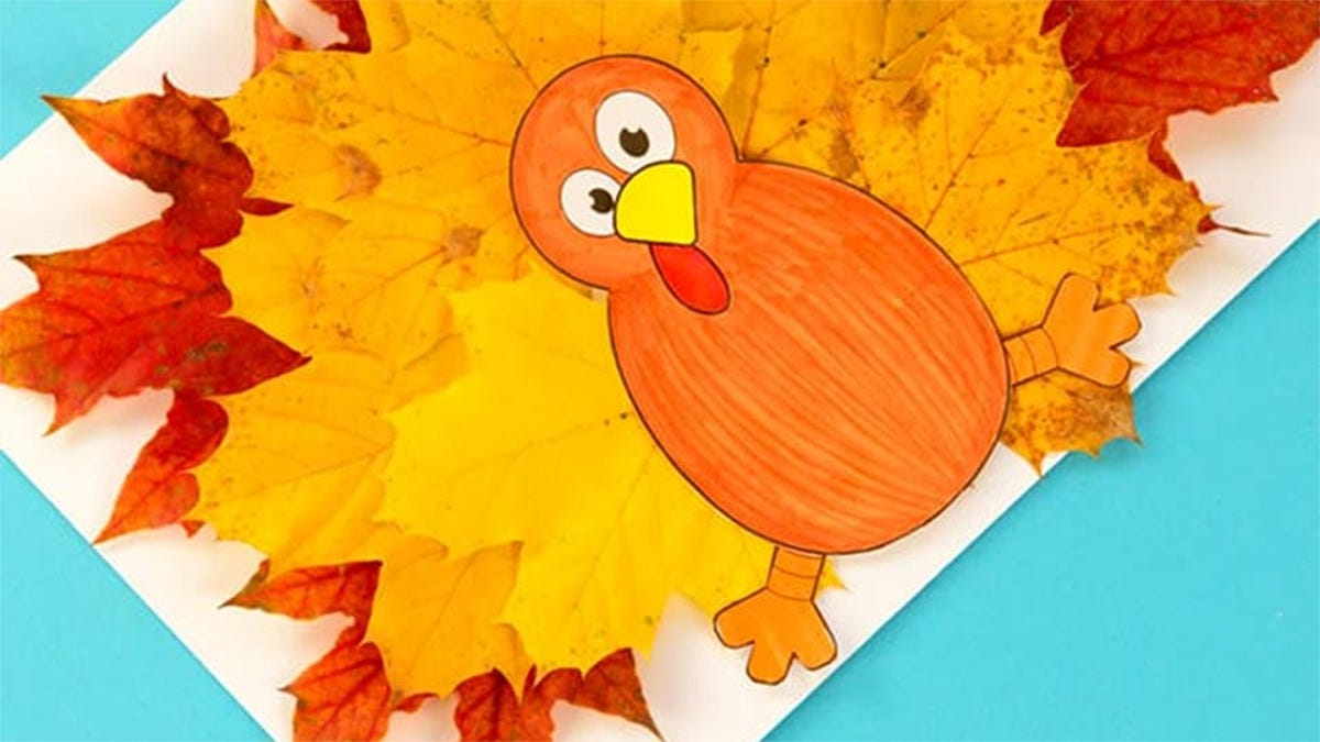 a colorful turkey decoration made from fall leaves