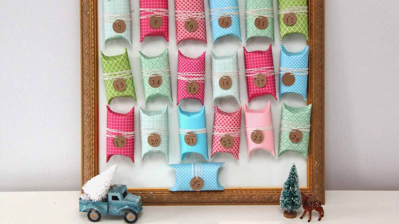 colorful advent calendar made from toilet paper tube sections wrapped in paper