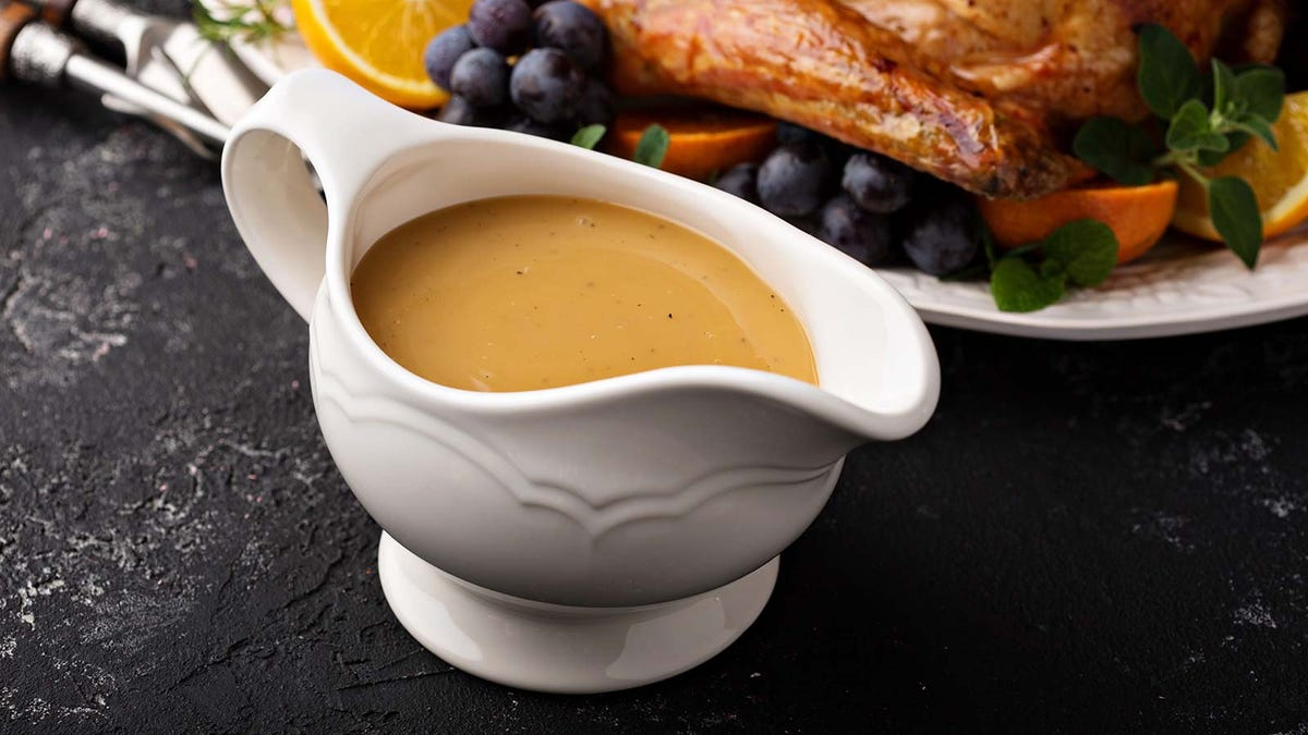 a big gravy boat filled with homemade turkey gravey