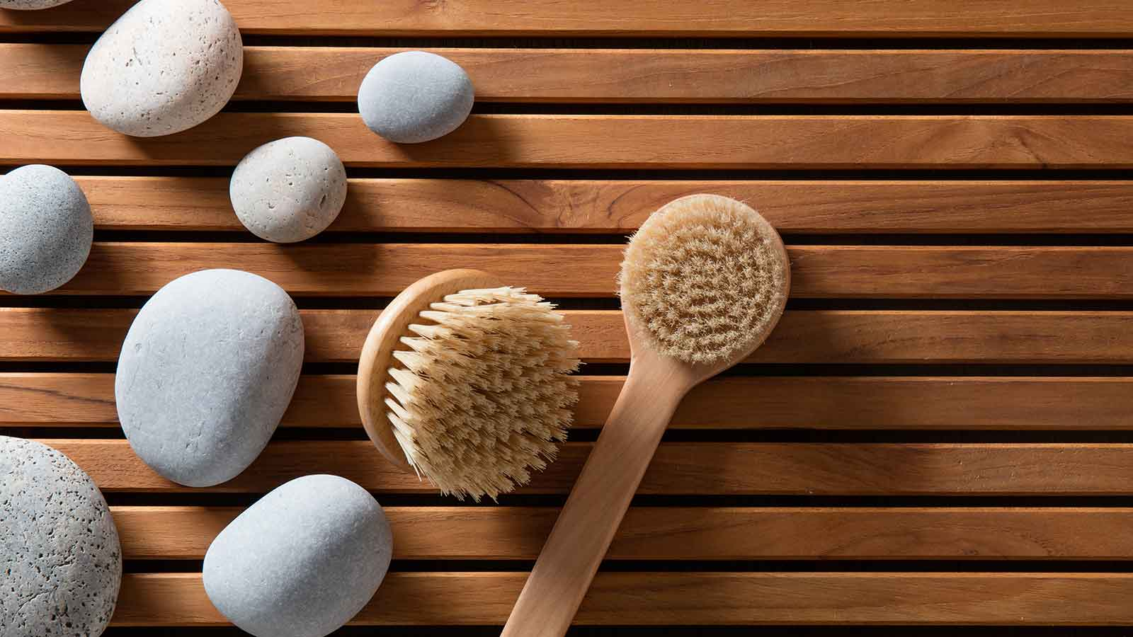 dry brushes in a spa resting on wooden slats