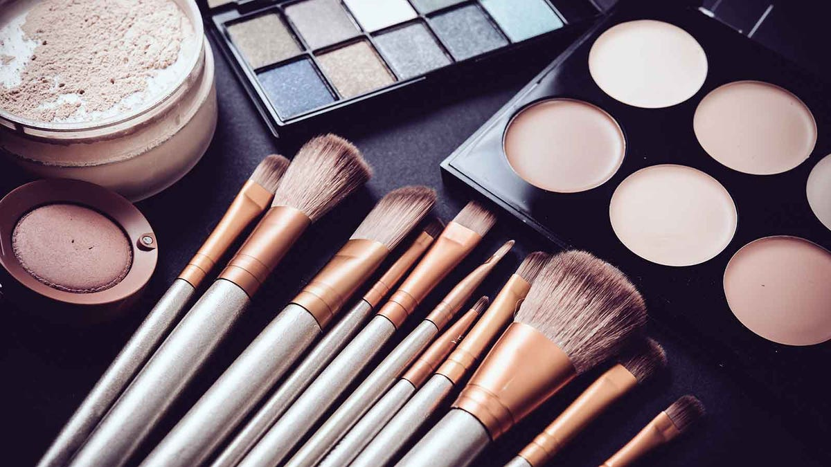makeup and makeup brushes on a vanity table