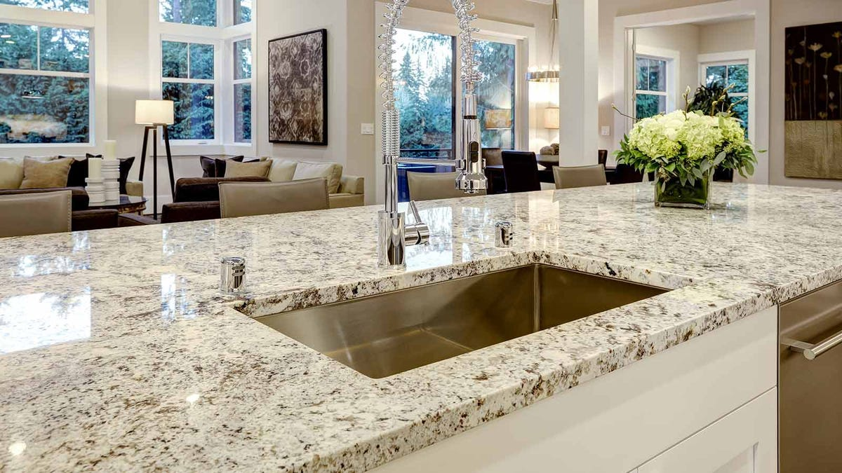 Beautiful light colored granite counters in an airy open kitchen.