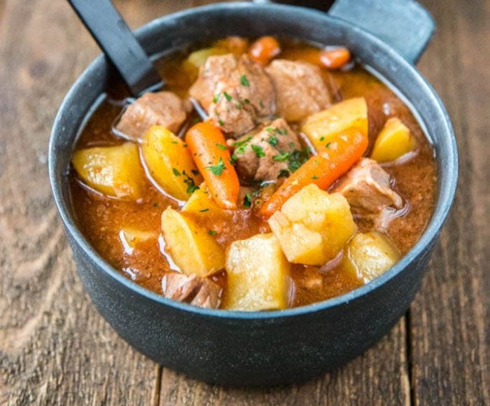A blue bowl filled with Irish Stew.