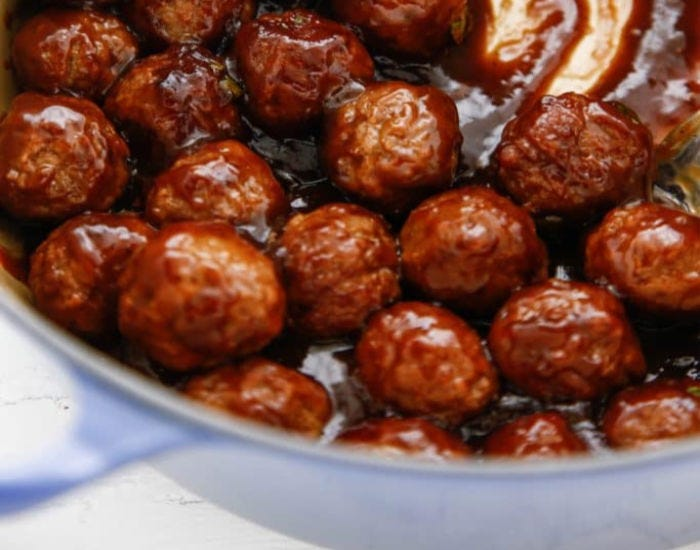 A pot full of barbecue beer meatballs.