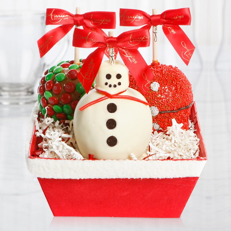 candied apples dressed as snowmen and santa