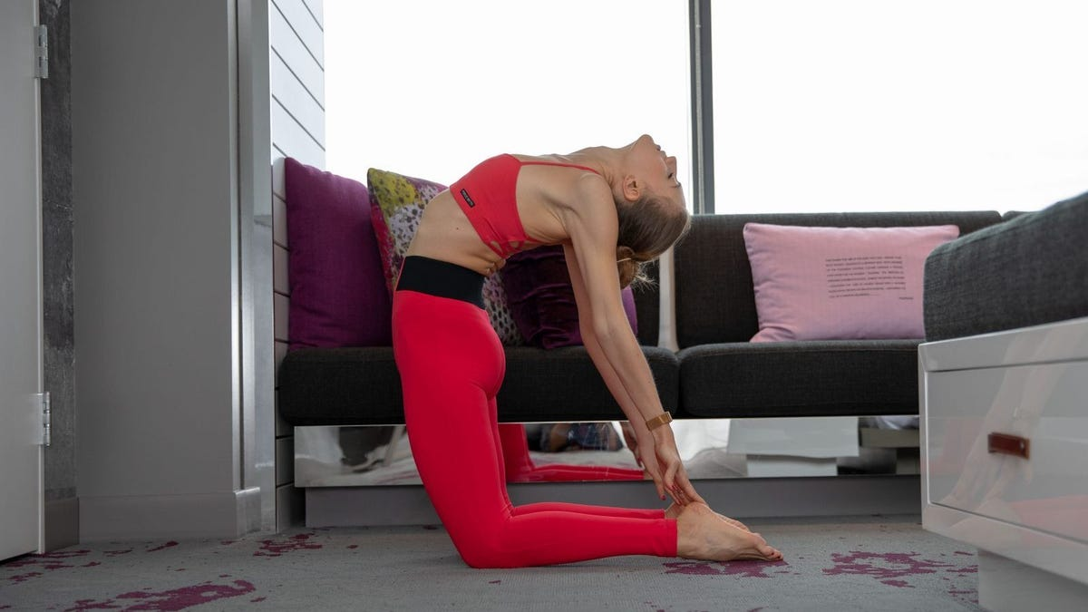 Woman doing yoga in a hotel room