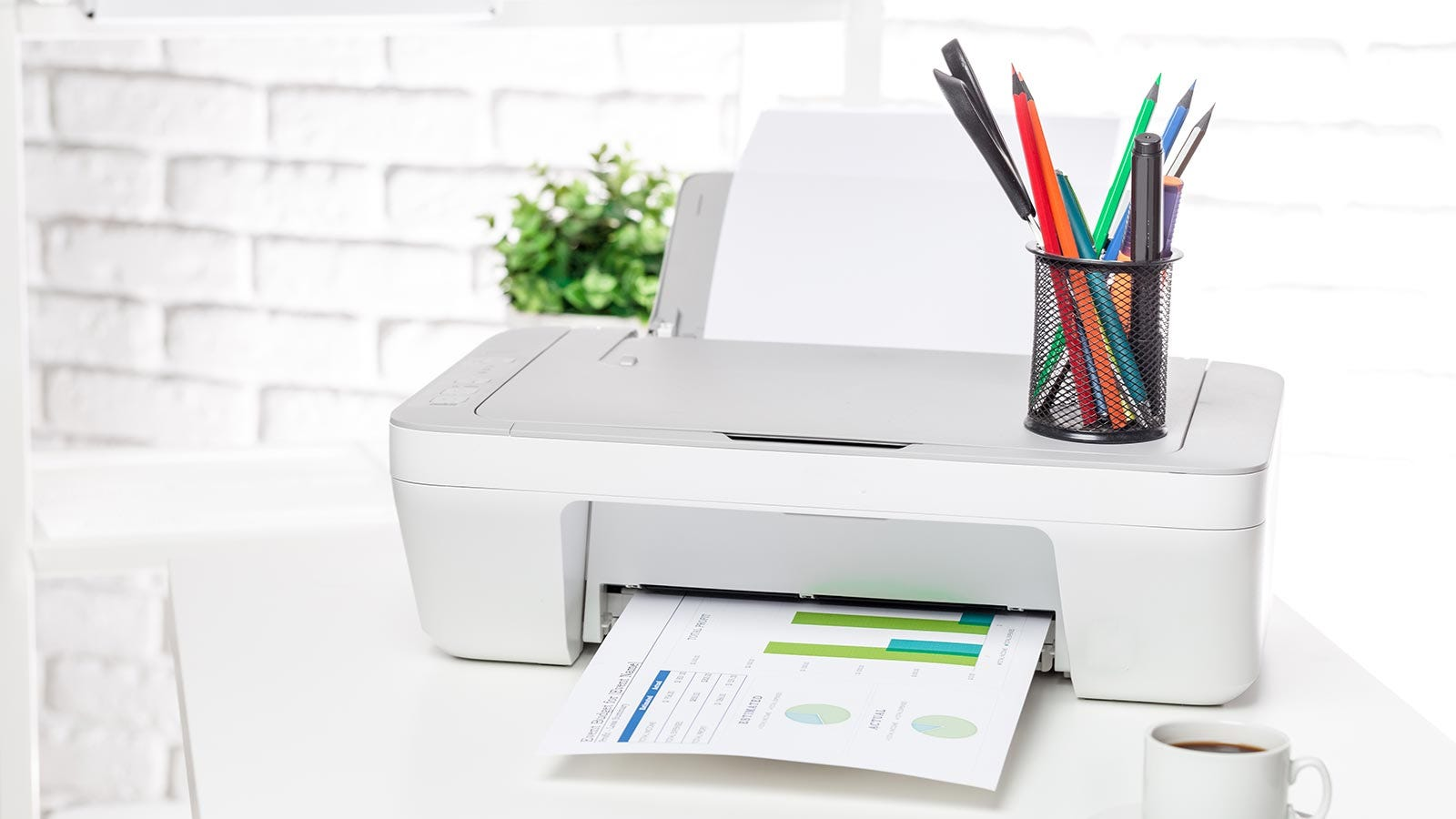 A home office printer sitting on a table.