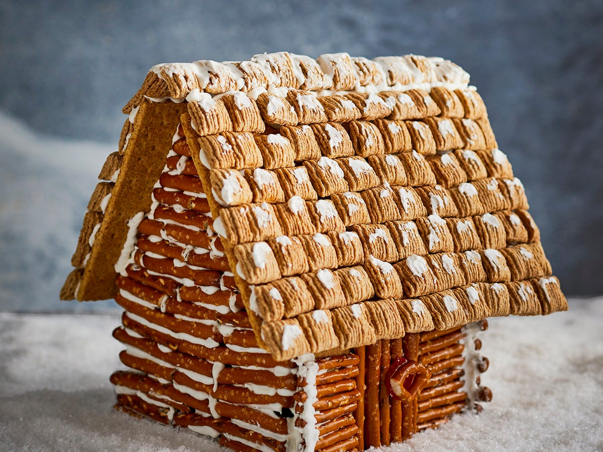 A gingerbread house covered in pretzels giving it a log cabin like appearance.