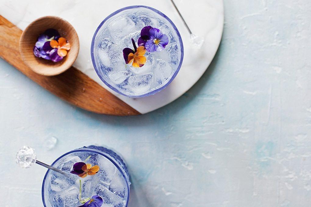 Two Fleur Collins cocktails.
