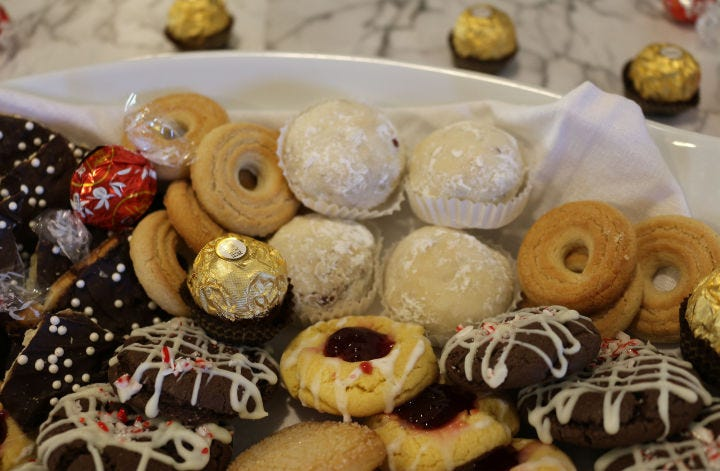 A cookie platter with various chocolate candies added.