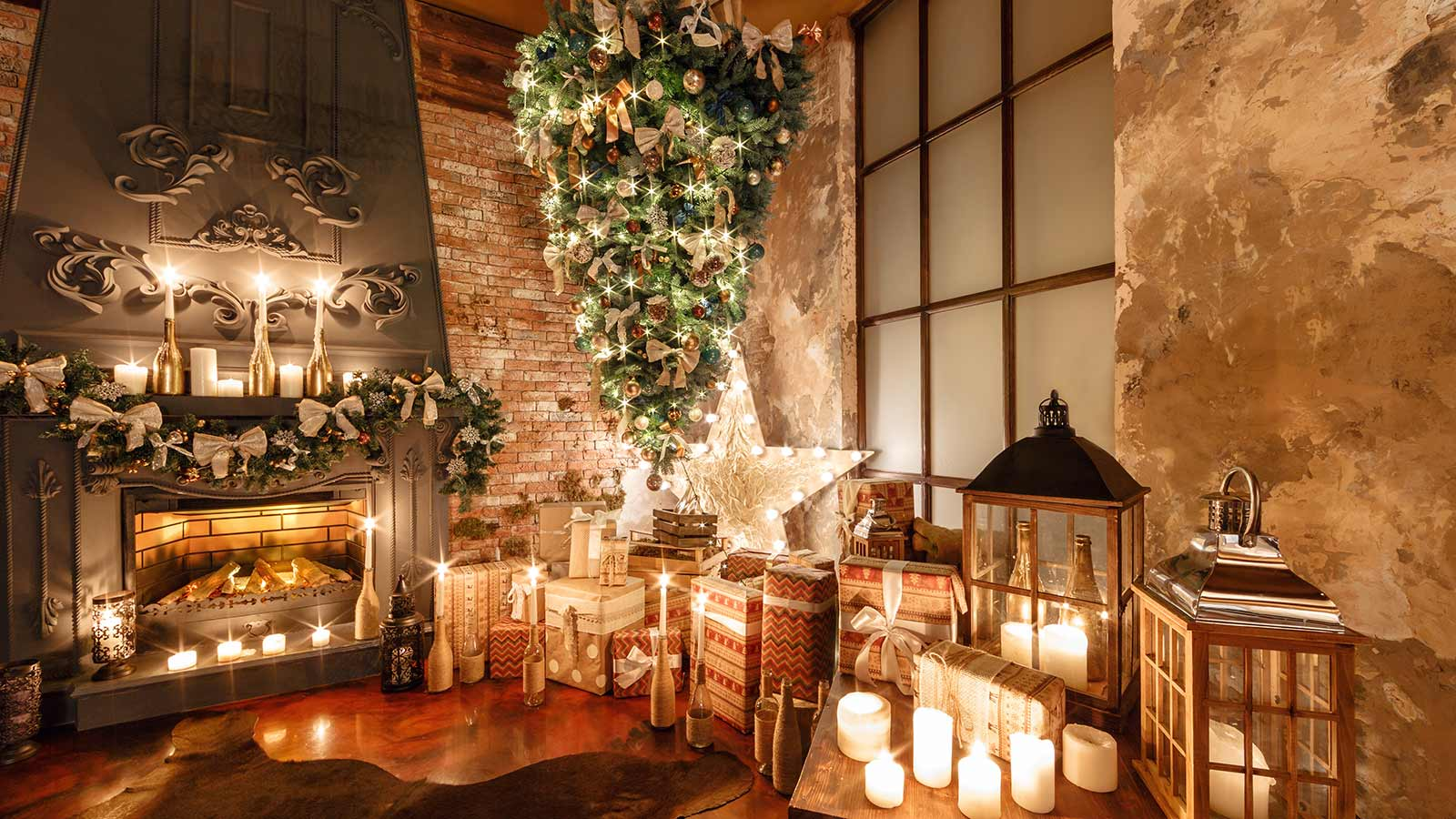 A beautifully decorated room with rustic decor and a large Christmas tree hanging upside down from the ceiling.