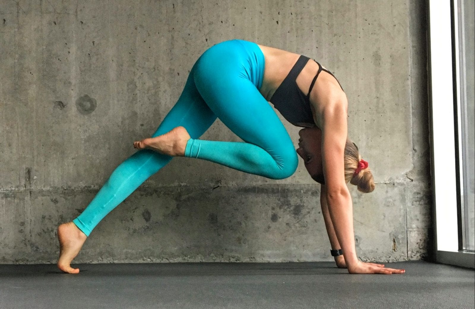 Woman doing yoga in blue leggings