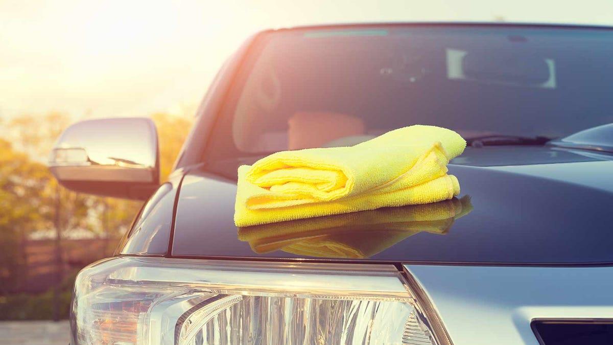a microfiber towel on the hood of an SUV