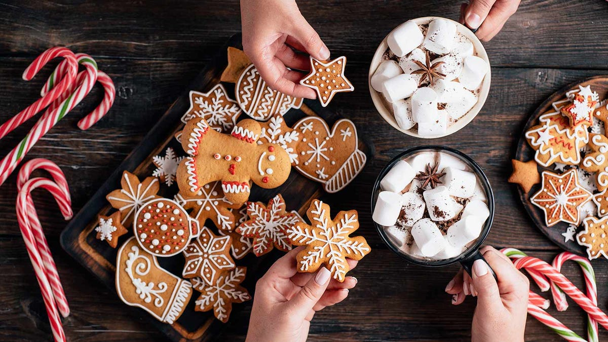 A table loaded with cookies, treats, and hot chocolate.