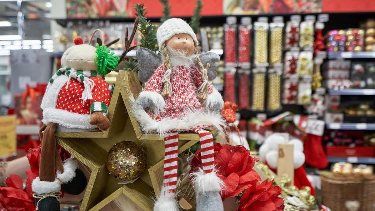 A pile of clearance Christmas items in a craft store.