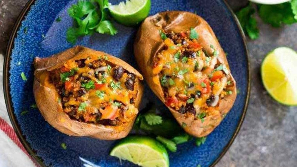 Two sweet potatoes loaded with black beans and quinoa.
