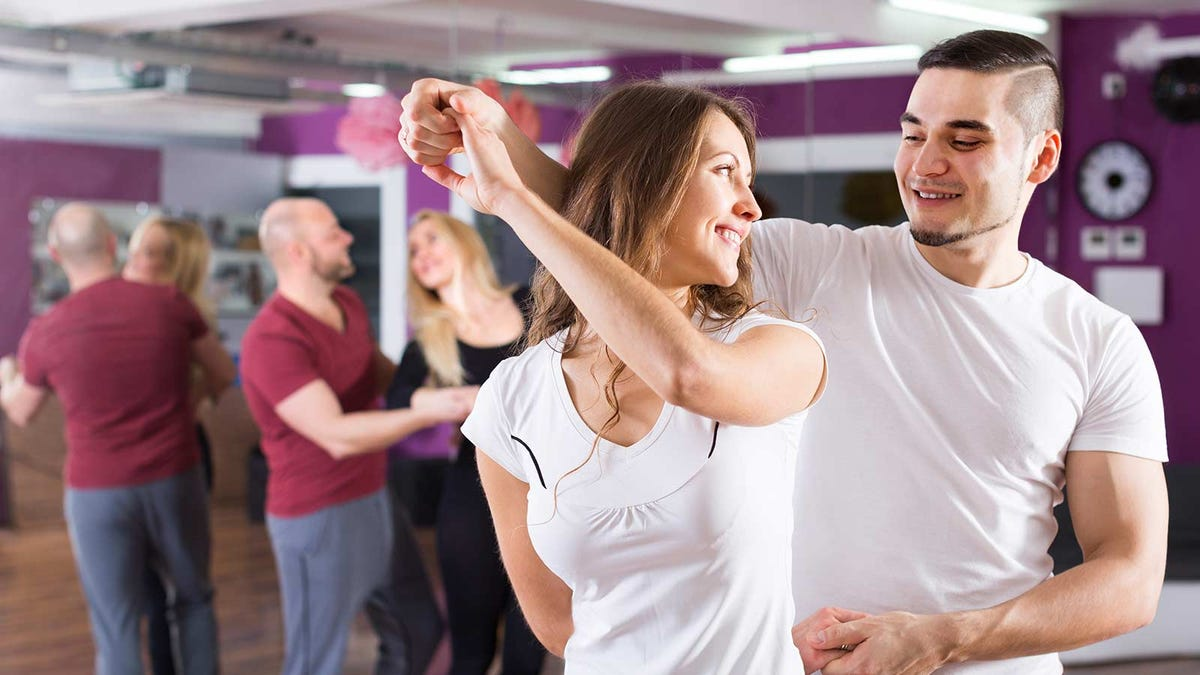 Couple taking a dance class with other couples.