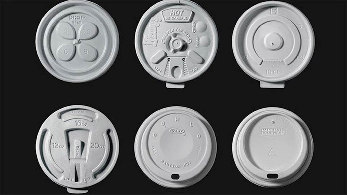 Examples of historic coffee cup lids on a black background.