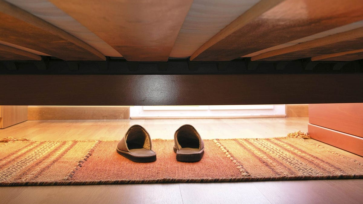Empty space under bed showing where boxes can be stored.
