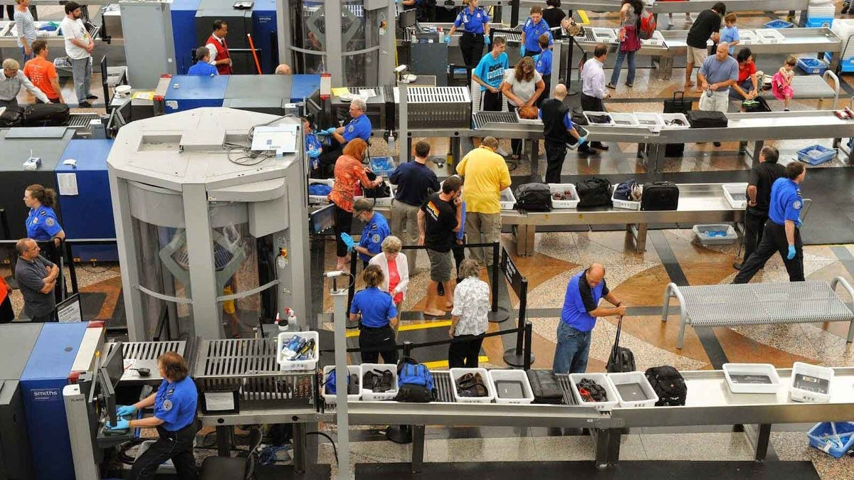 People working their way through TSA security lines