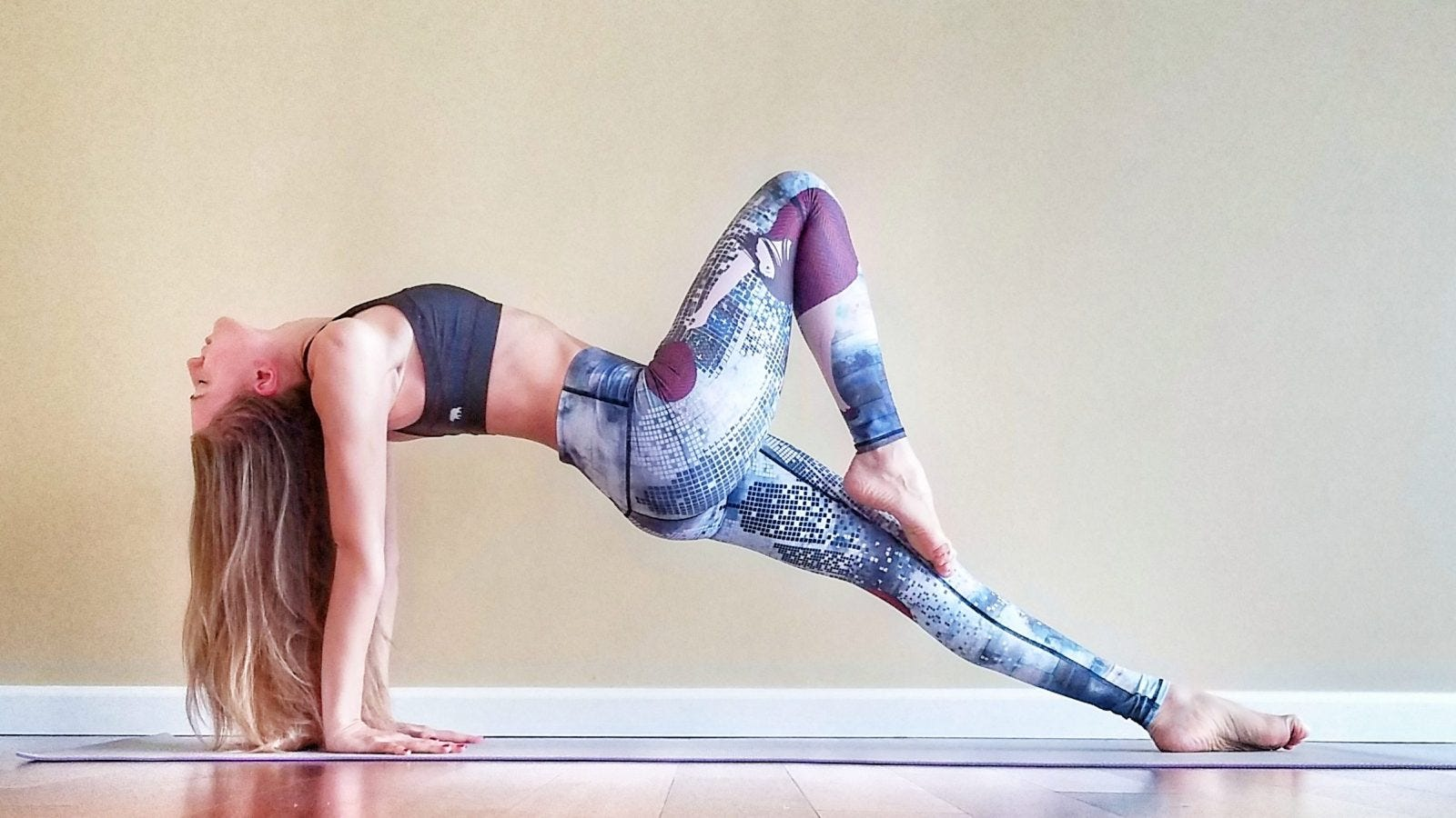 A woman stretching her upper body in a yoga pose.