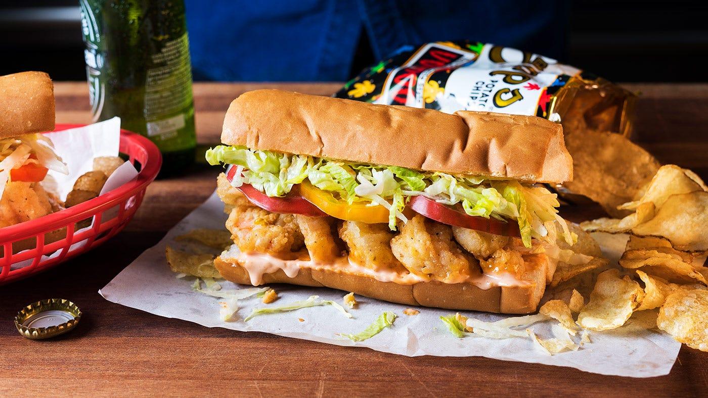 A po'boy sandwich on a table.