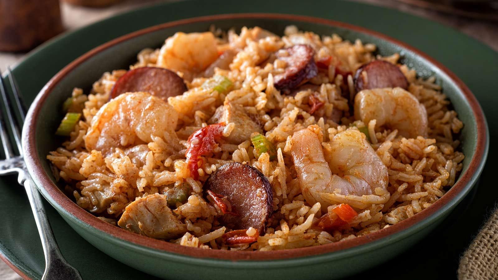 Bowl of Cajun-style jambalaya with shrimp, chicken, and sausage.