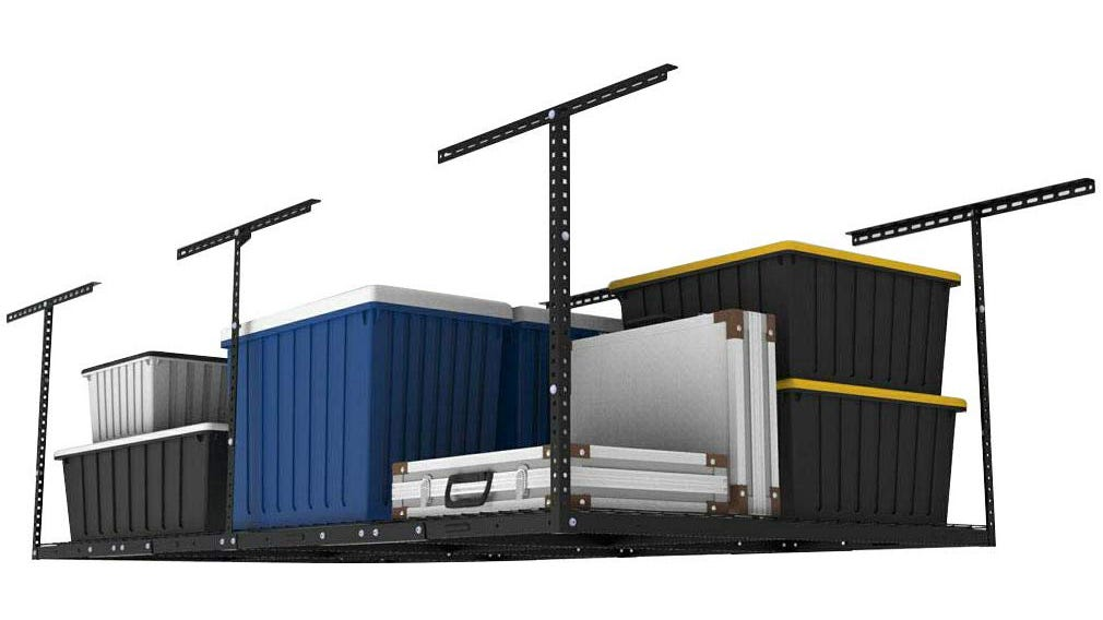 The FLEXIMOUNTS Overhead Garage Storage Rack holding large storage containers and folded stage risers.