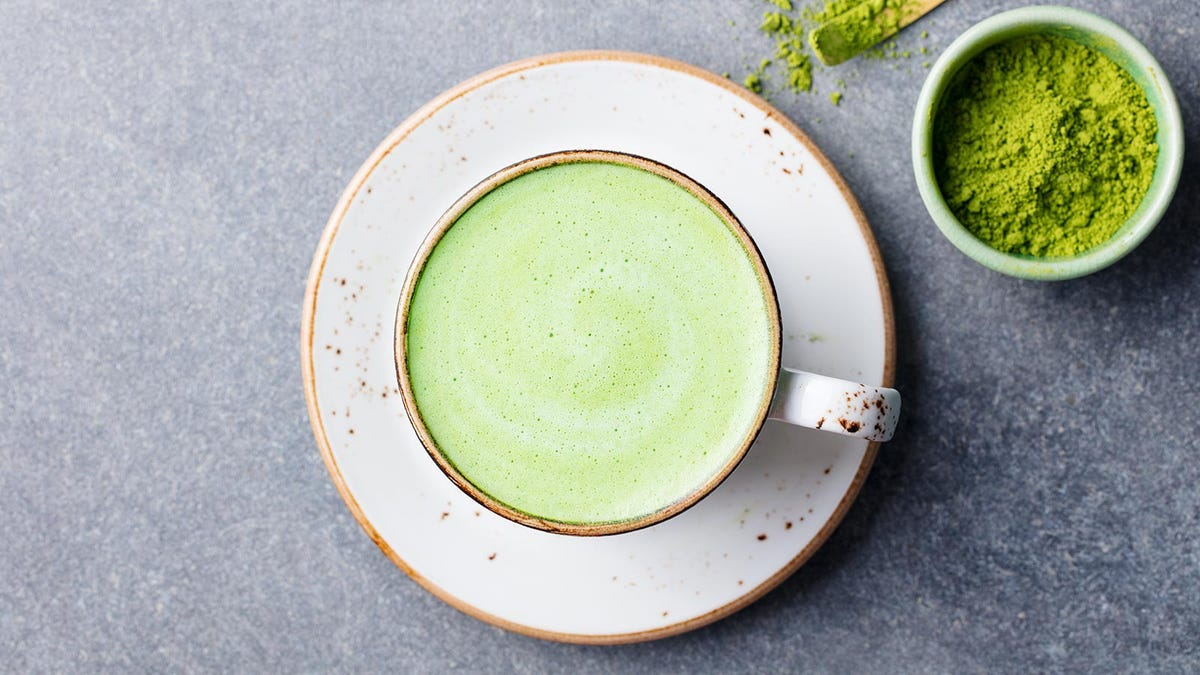 A matcha latte in a porcelain tea cup.