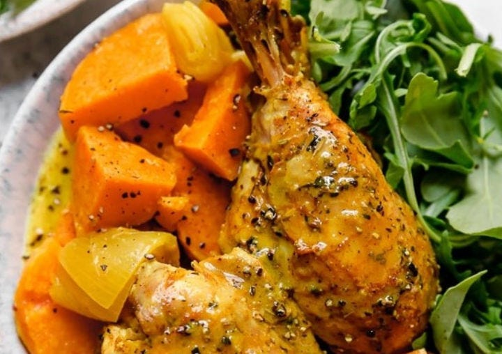 Turmeric Chicken and sweet potatoes with a side of arugula.