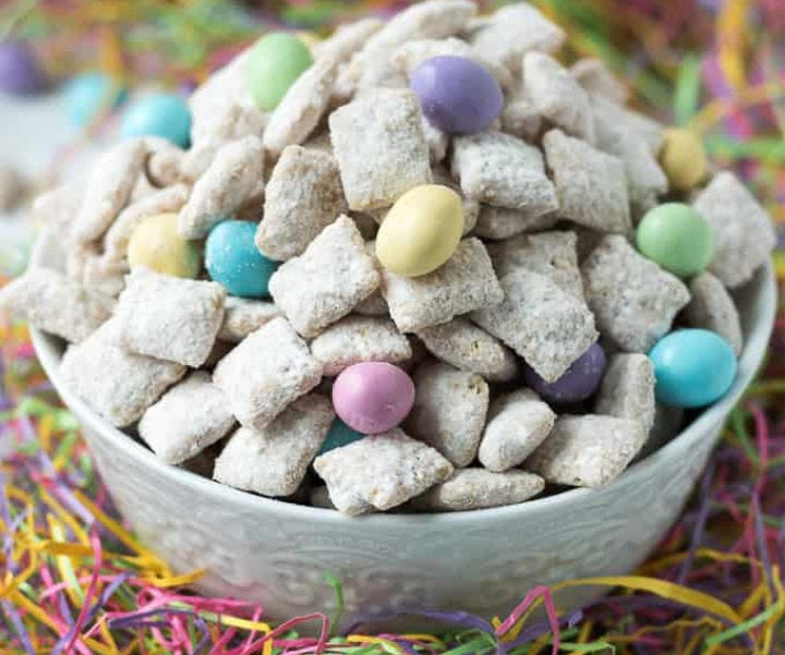 A bowl full of Easter-style Muddy Buddies.