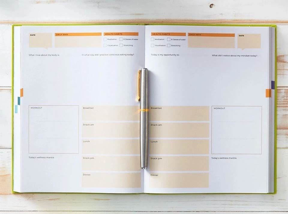A Dailygreatness journal open to a planning page.