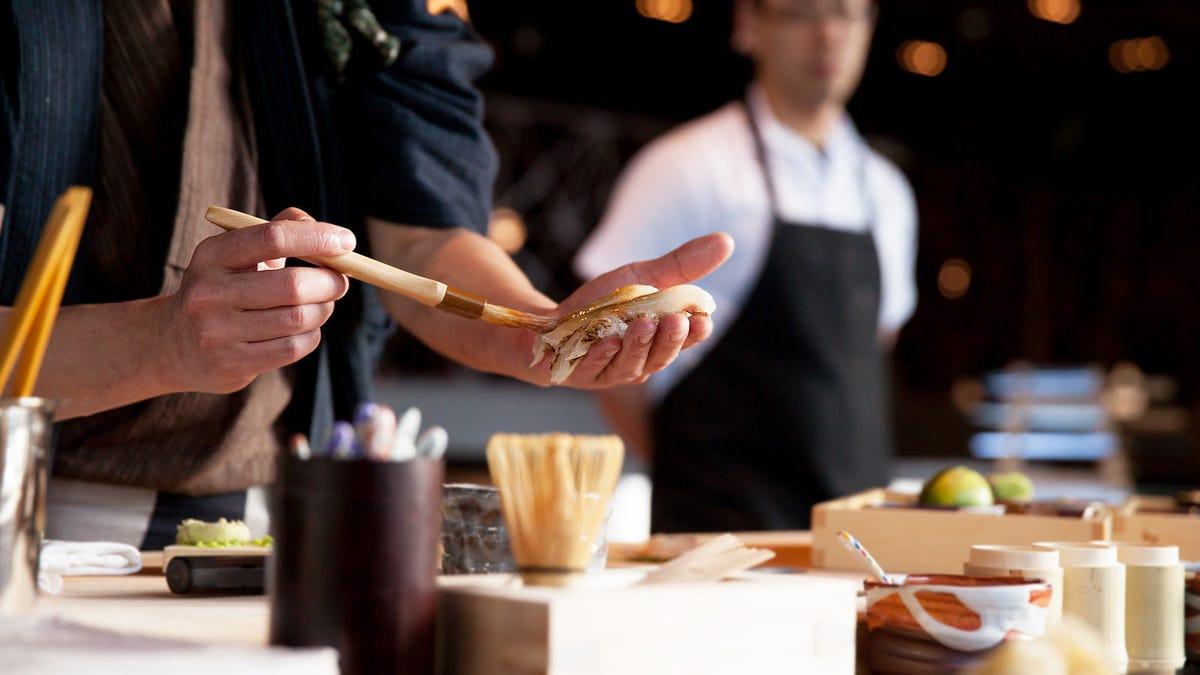 A sushi chef making omakase-style sushi.