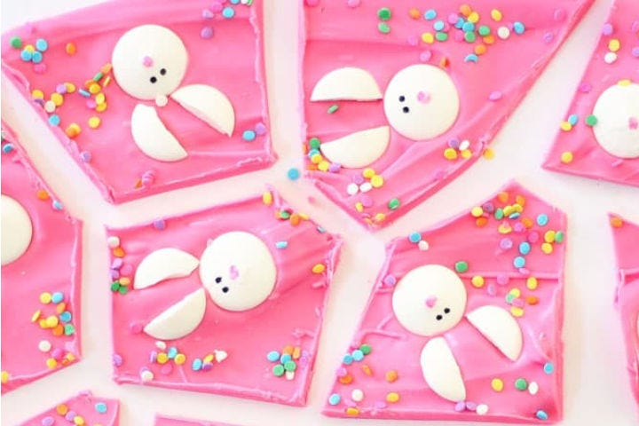 Separated pieces of bright-pink Bunny Bark with bunny rabbit faces and sprinkles on each.