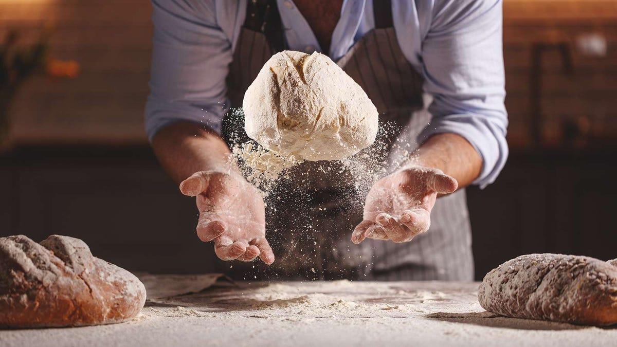 Man making fresh artisan bread at home.