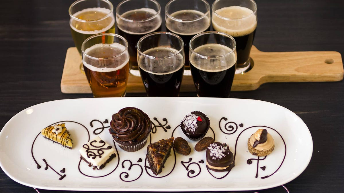 A flight of beers paired with a flight of pastries.