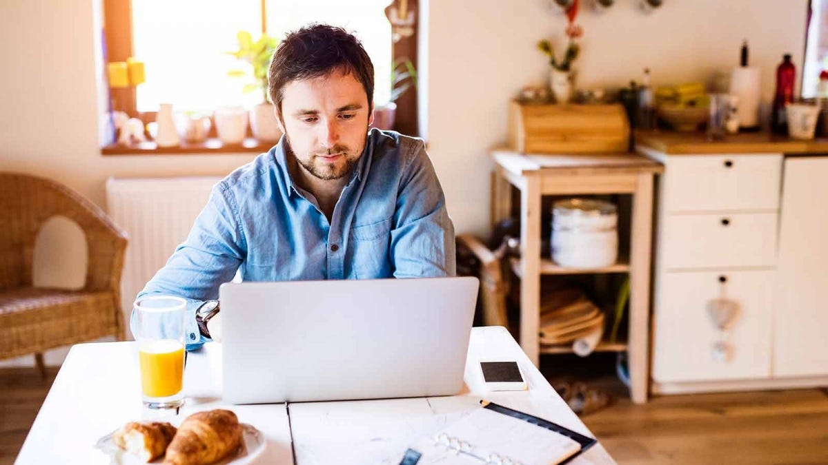 Man working from home at his kitchen table.