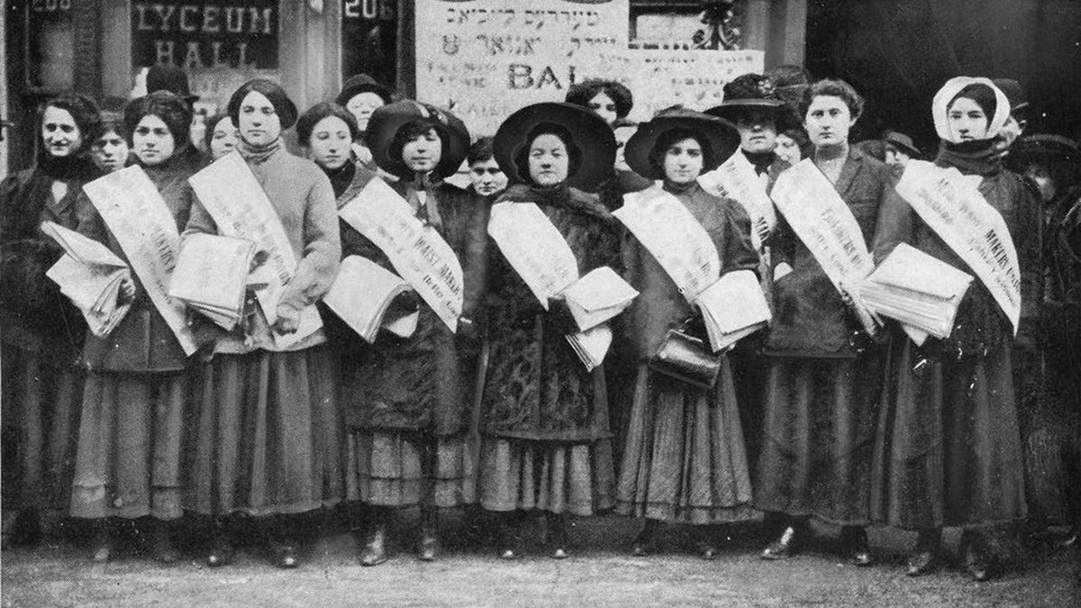 Early 20th century garment workers, going on strike.