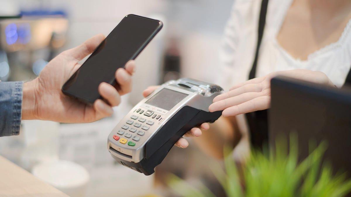 Man using a contactless payment terminal.