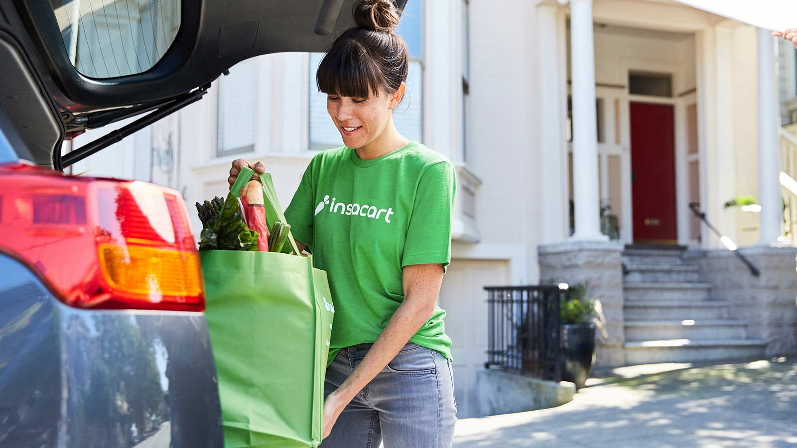 Woman unloading an Instacart delivery.