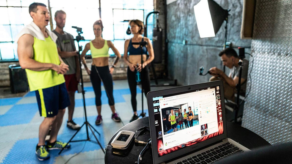 A group of fitness instructors preparing a YouTube video.