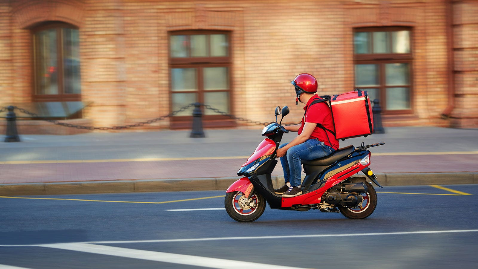 A deliveryman on a moped.