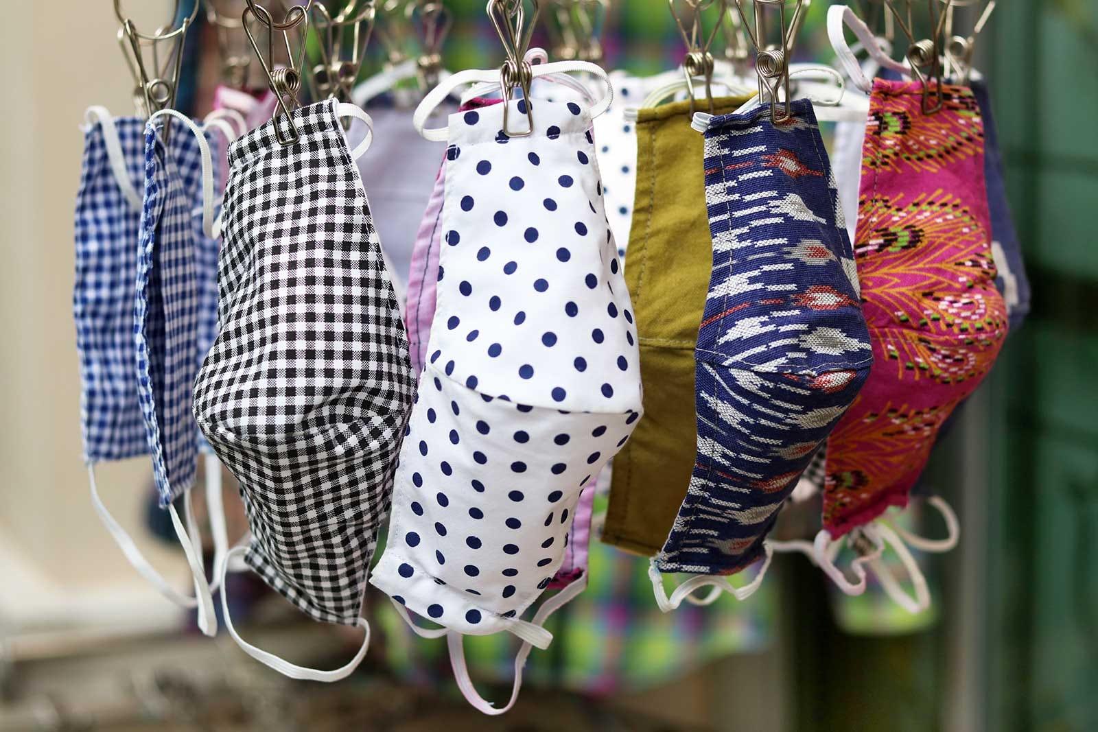 Cloth masks hang drying on a small drying rack.