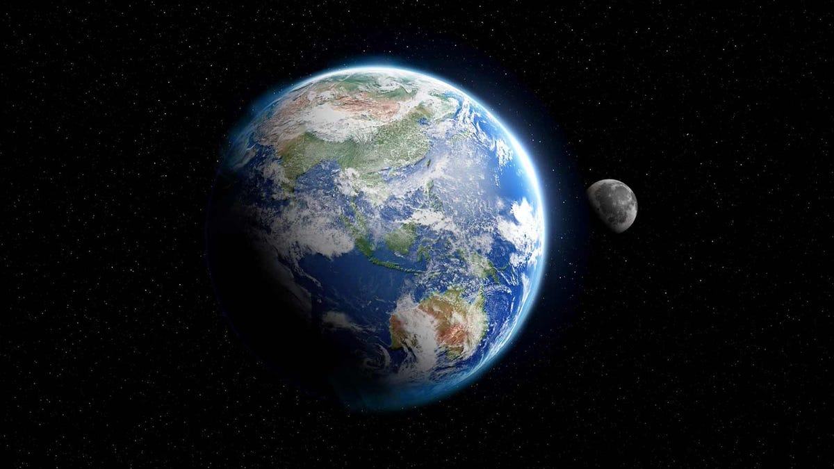 A deep space composite image of the Earth and moon by NASA.