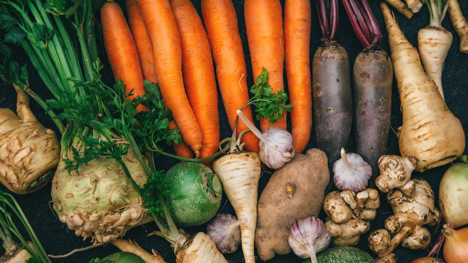 A selection of root vegetables like carrots, potatoes, and more.