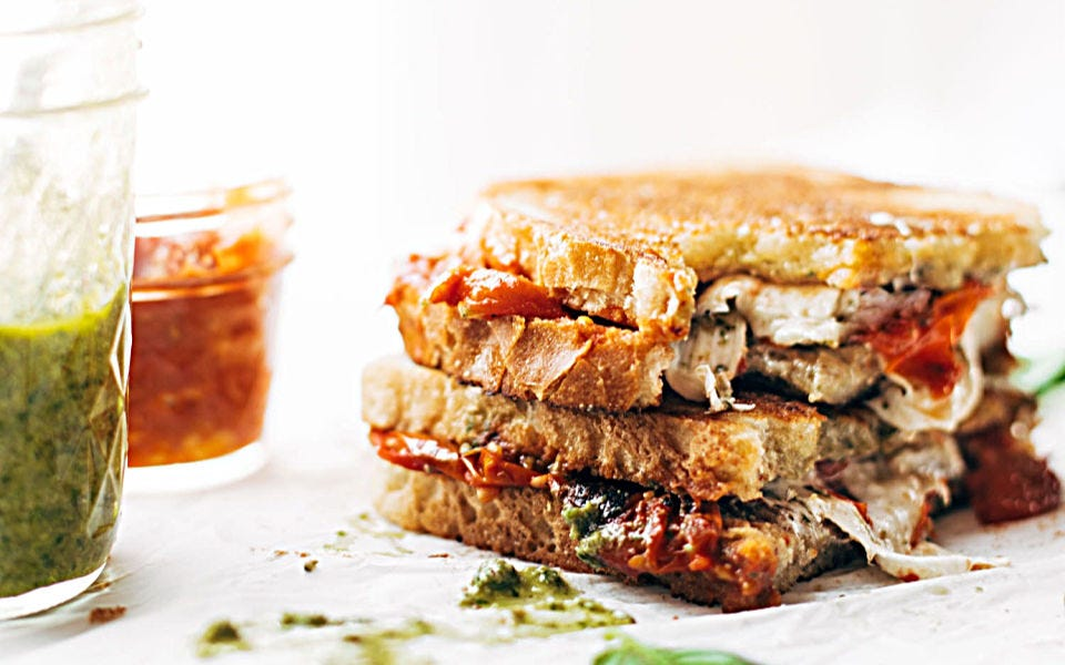 Loaded veggie caprese sandwich stuffed with tasty pesto flavors and cheese.