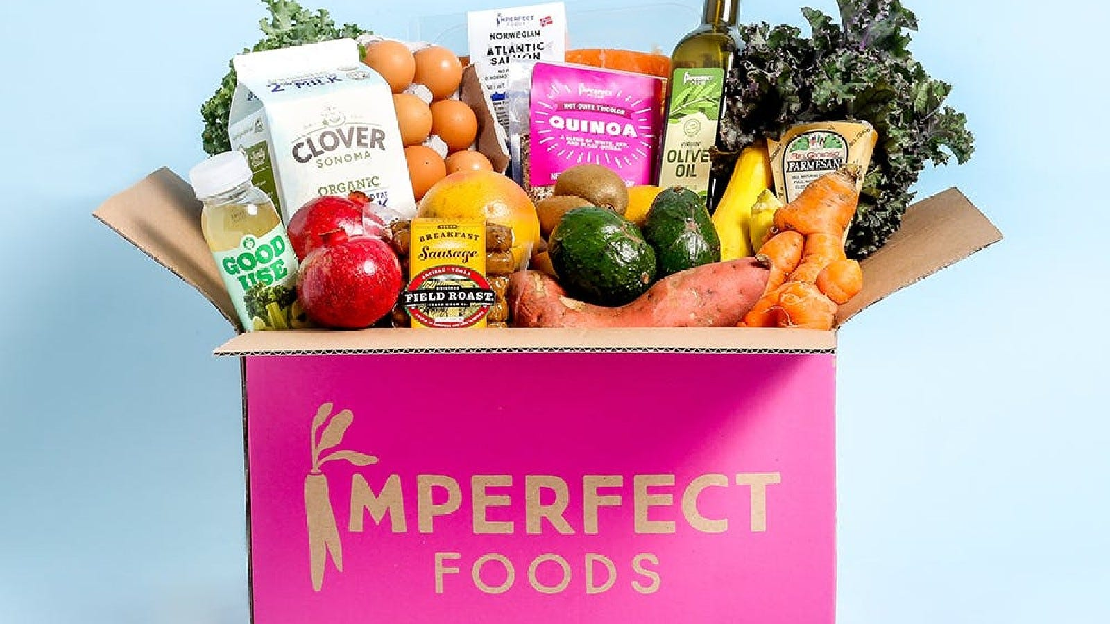 An Imperfect Foods box filled with fruits, veggies, milk, coffee, and other groceries.